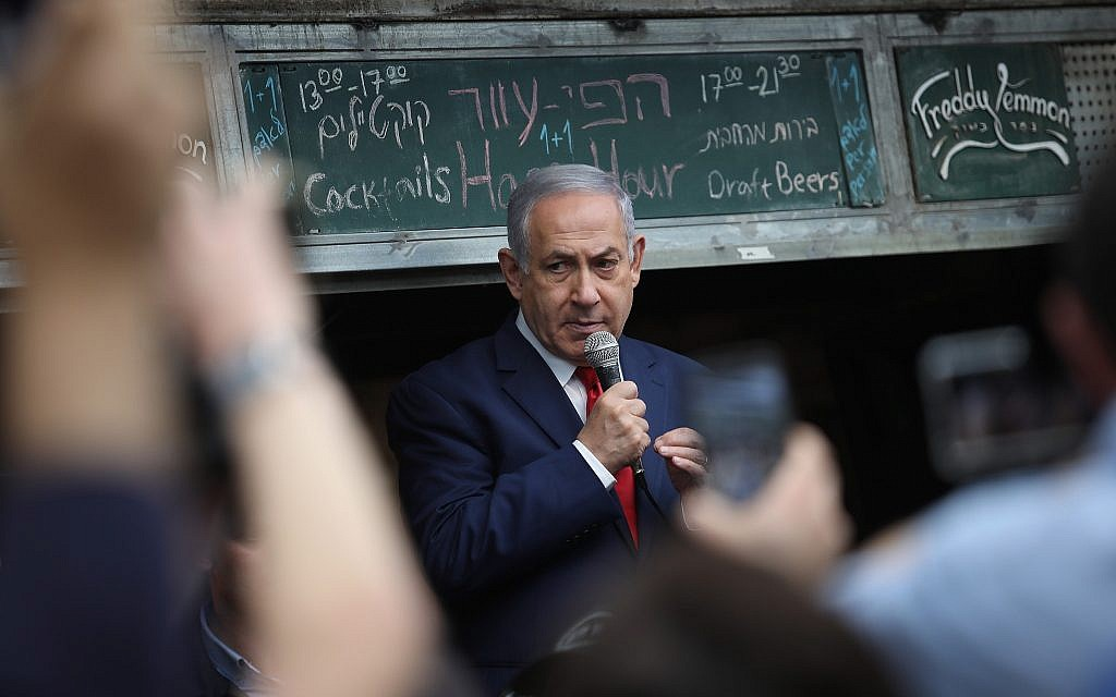 Prime Minister Benjamin Netanyahu seen during an election campaign tour in the Mahane Yehuda market in Jerusalem on April 8, 2019. (Hadas Parush/Flash90)