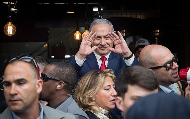 Prime Minister Benjamin Netanyahu seen during an election campaign visit to the Mahane Yehuda market in Jerusalem on April 8, 2019. (Yonatan Sindel/Flash90)
