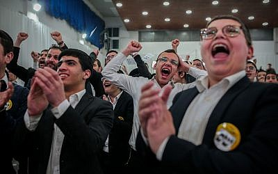 Supporters of the ultra-Orthodox Shas party celebrate at its Jerusalem headquarters after the publication of exit polls on April 9, 2019. (Flash90)