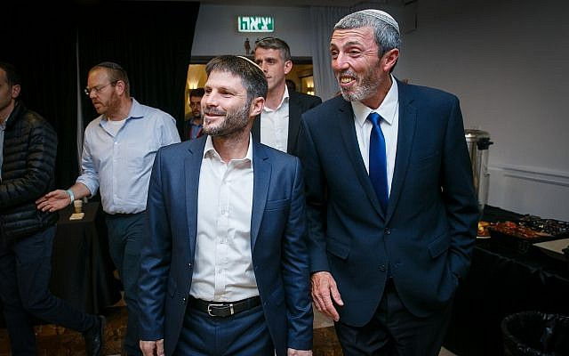 Union of Right-Wing Parties leader Rafi Peretz (R) and MK Bezalel Smotrich are greeted by supporters at the party headquarters, April 9, 2019. (Flash90)
