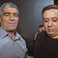 Labor party chairman Avi Gabbay (right) with party member Tal Russo as the results in the Israeli general elections are announced, at the party headquarters in Tel Aviv, on April 09, 2019. (Flash90)