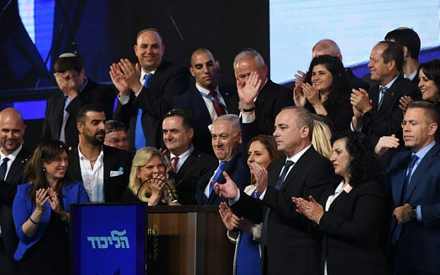Prime Minister Benjamin Netanyahu with Likud Party candidates and MKs attend an event as the results of the Israeli general elections are announced, at the party headquarters in Tel Aviv, on April 10, 2019. (Gili Yaari/FLASH90)