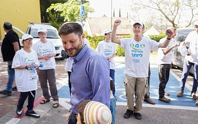 Union of Right Wing Parties MK Bezalel Smotrich walks into a polling station in the northern West Bank settlement of Kedumim on April 9, 2019. (Hillel Maeir/Flash90)