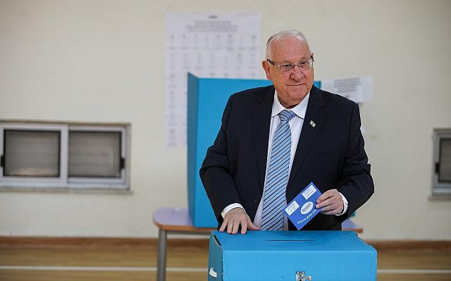 President Reuven Rivlin casts his ballot at a voting station in Jerusalem on April 9, 2019 (Hadas Parush/Flash90)