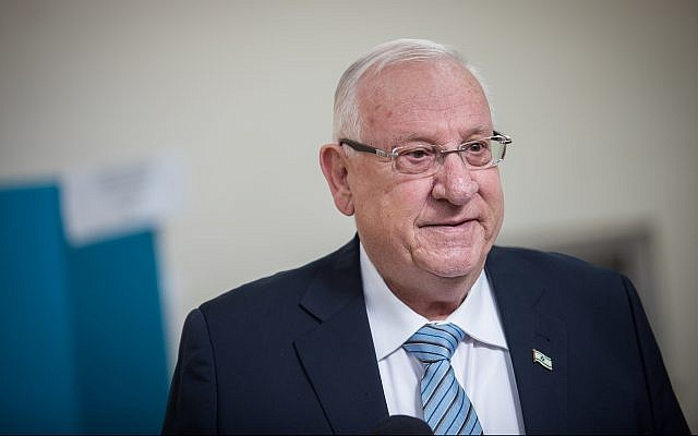 President Reuven Rivlin speaks with the press after casting his ballot at a voting station in Jerusalem, during elections for the Knesset, on April 9, 2019. (Hadas Parush/Flash90)