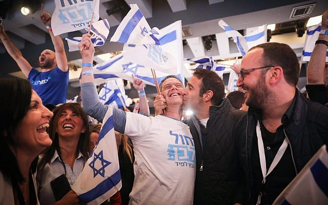 Supporters of the Blue and White political party react to the first voting results in the Israeli general elections, at the party headquarters in Tel Aviv, on April 09, 2019. (Hadas Parush/FLASH90)