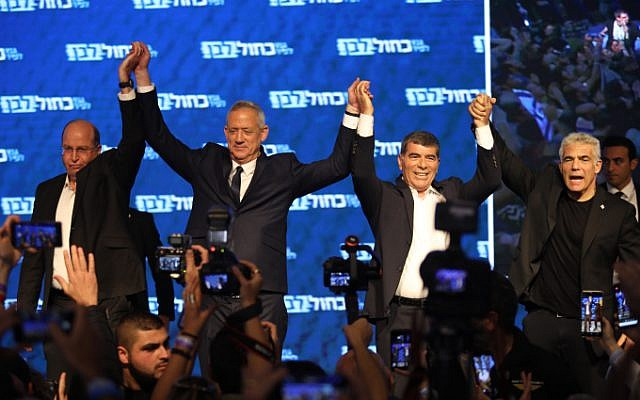 Head of the Blue White party Benny Gantz (2L) and his top allies Moshe Ya'alon, Gabi Ashkenazi and Yair Lapid greet supporters following the release of exit polls at the party headquarters in Tel Aviv, on April 9, 2019 (Hadas Parush/Flash90)