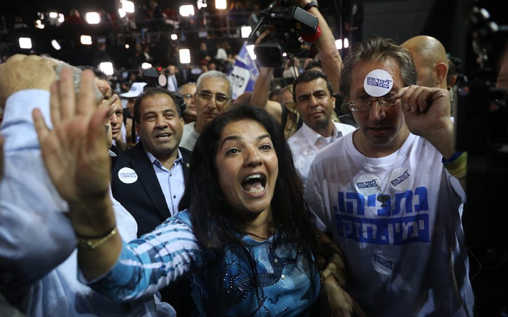 Likud supporters react to the first voting results in the Israeli general elections, at the Likud party headquarters in Tel Aviv, on April 9, 2019. (Yonatan Sindel/Flash90)