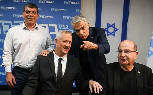 Members of the Blue White political party Benny Gantz (second left), Moshe Yaalon (right), Gabi Ashkenazi (left) and Yair Lapid hold a press conference at the party headquarters in Tel Aviv, on April 10, 2019, a day after the elections. (Flash90)