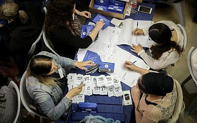 Israelis count the remaining ballots from soldiers and absentees at the parliament in Jerusalem, a day after the general elections, April 10, 2019. (Noam Revkin Fenton/Flash90)