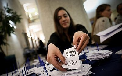 Officials count the remaining ballots from soldiers and absentees at the Knesset in Jerusalem, a day after the general elections, April 10, 2019. (Noam Revkin Fenton/Flash90)
