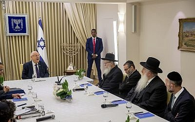 Members of the United Torah Judaism party meet with President Reuven Rivlin at the President's Residence in Jerusalem on April 15, 2019. (Yonatan Sindel/Flash90)