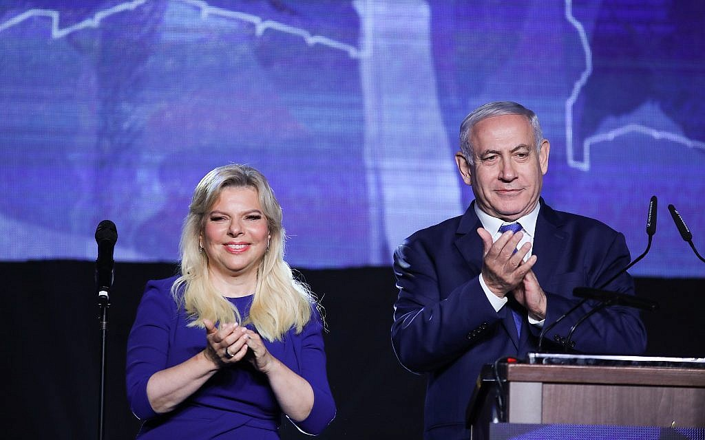 Prime Minister Benjamin Netanyahu (R) and his wife Sara at an event of the Likud party in Jerusalem, April 16, 2019. (Hadas Parush/Flash90)