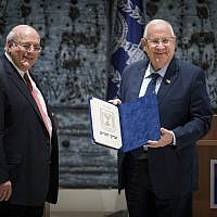 Chairman of the Central Elections Committee Hanan Melcer presents the official results of the Knesset elections to President Reuven Rivlin at the President's Residence in Jerusalem, April 17, 2019. (Hadas Parush/Flash90)