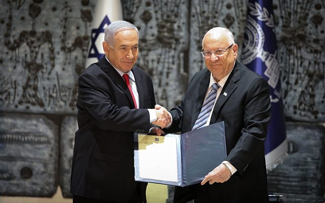 Israel's President Reuven Rivlin (right) and Prime Minister Benjamin Netanyahu at the president's residence in Jerusalem on April 17, 2019. (Noam Revkin Fenton/Flash90)