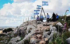 Israelis visit the Jewish settlement of Peduel, in Samaria, West Bank, on April 22, 2019. (Flash90)
