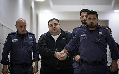 Daniel Nachmani, accused in the murder of Noa Eyal, is taken from the courtroom of the Jerusalem District Court on April 29, 2019. (Hadas Parush/Flash90)