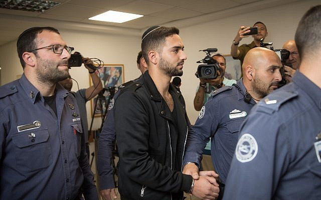 Netanel Sandrusi is taken to the traffic court in Jerusalem after being arrested on suspicion that he ran over an 11-year-old child, critically wounding him, and then fleeing the scene, April 29, 2019. (Hadas Parush/Flash90)