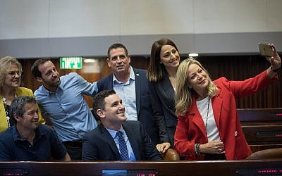 New Knesset members from the Blue and White pose in their newly allocated Knesset plenary seats, April 29, 2019. At right is Miki Haimovich. (Noam Moscowitz/Knesset)