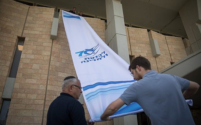 Parliament workers seen preparing the Knesset for the opening session of the 21st legislative session on April 29, 2019. (Noam Revkin Fenton/FLASH90)