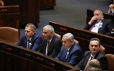 Left to right, front row: Public Security Minister Gilad Erdan, Finance Minister Moshe Kahlon, Prime Minister Benjamin Netanyahu, and Acting Foreign Minister Israel Katz in the Knesset's plenary hall during the swearing-in ceremony of Knesset members as a new session opens following the 2019 elections, on April 30, 2019. (Noam Revkin Fenton/Flash90)