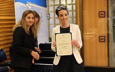 Idit Silman of Union of Right-Wing Parties holds a certificate congratulating her on her election to the 21st Knesset, April 30, 2019 (Courtesy of the Knesset)