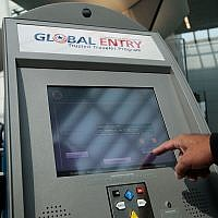 An officer with the US Customs and Border Protection demonstrates a new arrivals processing kiosk at Newark International Airport in Newark, New Jersey, August 24, 2009. (Chris Hondros/Getty Images via JTA)