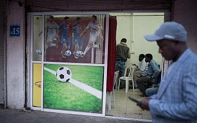 The door of Mohammed's cafe is decorated to let customers know exactly what kind of entertainment will be featured on screen.(Hadas Porush/Flash90)