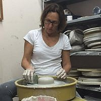 Chen Barak, the CEO of Nanomedic Technologies, in her pottery class (Courtesy)