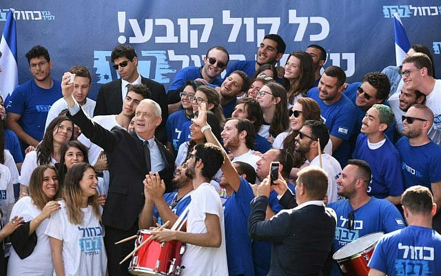 Blue and White party leader Benny Gantz takes a selfie with activists at the party headquarters, April 8, 2019. (Sraya Diamant)
