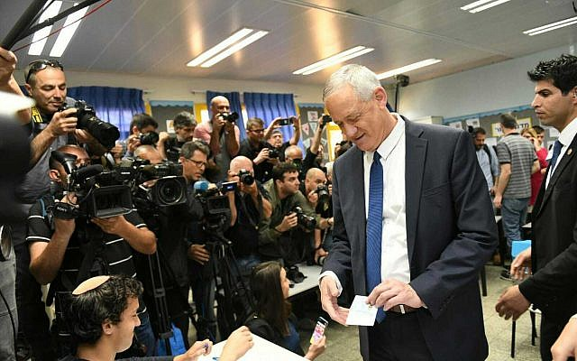 Blue and White leader Benny Gantz votes at a polling station in his hometown of Rosh Ha'ayin on April 9, 2019. (Raoul Wootliff/Times of Israel)