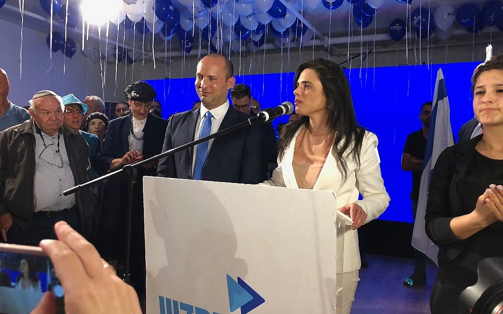 New Right co-leaders Ayelet Shaked and Naftali Bennett address supporters at their campaign headquarters in Bnei Brak at the end of election day, April 9, 2019. (Jacob Magid/Times of Israel)