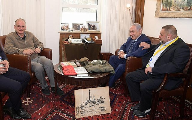 Prime Minister Benjamin Netanyahu, center, and Dr. Ido Netanyahu, left, receive the personal effects of their brother Yoni in Jerusalem on April 15, 2019. (Amos Ben-Gershom/GPO)