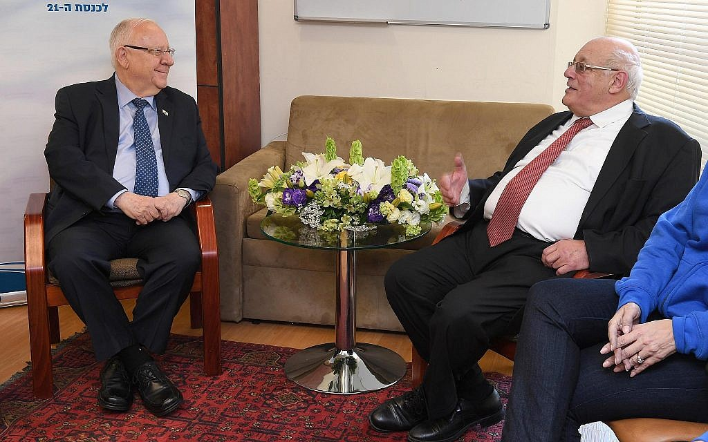 President Reuven Rivlin (L) meets with Supreme Court Justice Hanan Melcer, the head of the Central Elections Committee, in Jerusalem on April 10, 2019. (Mark Neiman/GPO)