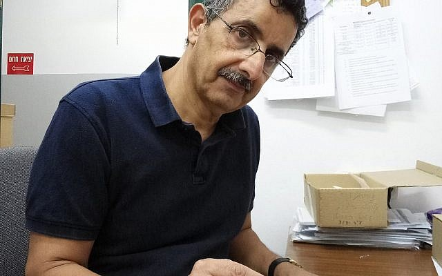 Bar-Ilan University Prof. Zohar Amar and the remnants of 2,600-year-old chicken eggs discovered in the City of David. (Bar-Ilan University)