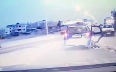 Police footage of a woman being dragged along with her parents' car in the town of Rahat on April 5, 2019. (Israel Police)