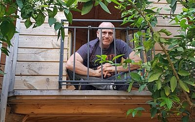 CropX CEO Tomer Tzach in the tree house he built for his children at his home in Zichron Yaakov (Courtesy)