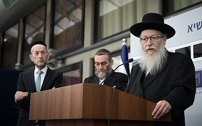 Deputy Health Minister Yaakov Litzman, right, of United Torah Judaism holds a press conference after meeting with President Reuven Rivlin, April 15, 2019. (Yonatan Sindel/Flash90)