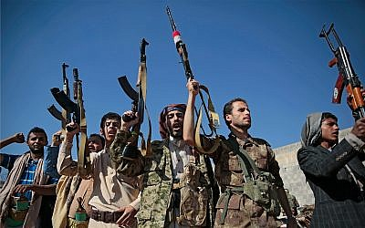 Tribesmen loyal to Houthi rebels attend a gathering to show their support for the ongoing peace talks being held in Sweden, in Sanaa, Yemen, December 13, 2018. (AP Photo/Hani Mohammed)