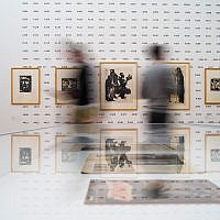 People look at work of Emil Nolde at an exhibition about the artist at the Hamburger Bahnhof museum in Berlin, Germany, April 11, 2019. (AP Photo/Markus Schreiber)