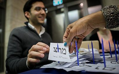 The Central Elections Committee counts the remaining ballots from soldiers and absentees, at the Knesset in Jerusalem, a day after the general elections, April 10, 2019. (Noam Revkin Fenton/Flash90)