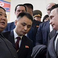 Russian President Vladimir Putin (right), and North Korea's leader Kim Jong Un (left) take an escalator after talks in Vladivostok, Russia, on April 25, 2019. (Alexei Nikolsky, Sputnik, Kremlin Pool Photo via AP)
