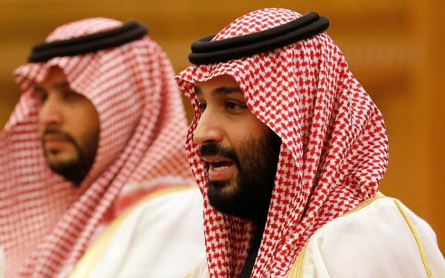Saudi Crown Prince Mohammad bin Salman, right, speaks during a meeting in Beijing, China, February 22, 2019. (How Hwee Young/Pool Photo via AP, File)