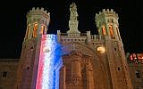 The Notre Dame center in Jerusalem is illuminated with the colors of the French flag in solidarity with Paris, April 18, 2019. (Courtesy/Arnon Bosani)