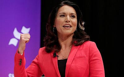 Democratic presidential candidate Rep. Tulsi Gabbard, D-Hawaii, answers questions during a presidential forum held by She The People on the Texas State University campus in Houston, April 24, 2019. (AP Photo/Michael Wyke)