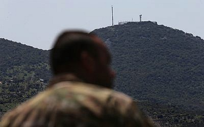 An Israeli military position is seen on a hill over Kfar Chouba, southeast Lebanon. April 9, 2019. (AP Photo/Hussein Malla)