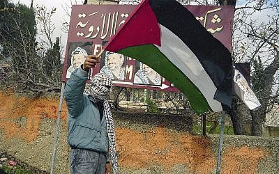 Illustrative: A PLO supporter in the West Bank, January 5, 1988. A 50-year-old California man was stripped of his US citizenship on Friday for lying to immigration authorities when he became a citizen about his conviction for an attempted 1988 PLO terrorist bombing. (AP Photo/Anat Givon)
