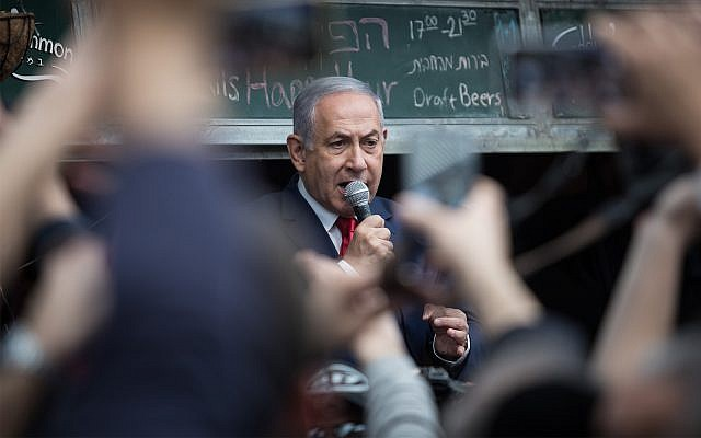 Prime Minister Benjamin Netanyahu seen during an election campaign tour in the Mahane Yehuda market in Jerusalem, April 8, 2019. (Hadas Parush/Flash90)