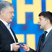 Ukrainian President Petro Poroshenko, left, and Ukrainian presidential candidate and popular comedian Volodymyr Zelensky, right, argue their debates at the Olympic stadium in Kiev, Ukraine, April 19, 2019. (AP Photo/Vadim Ghirda)