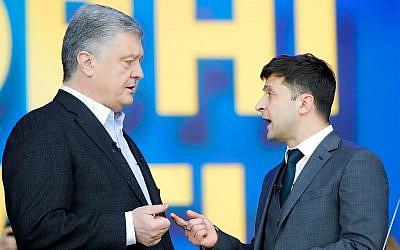 Ukrainian President Petro Poroshenko, left, and Ukrainian presidential candidate and popular comedian Volodymyr Zelensky, right, argue their debates at the Olympic stadium in Kiev, Ukraine, April 19, 2019. (AP Photo/Vadim Ghirda)